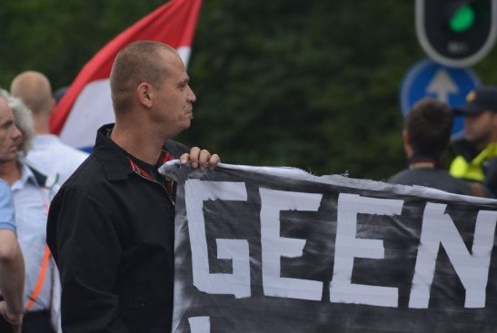NVU member Johnboy Willemse on the left of the banner at the 10 August march